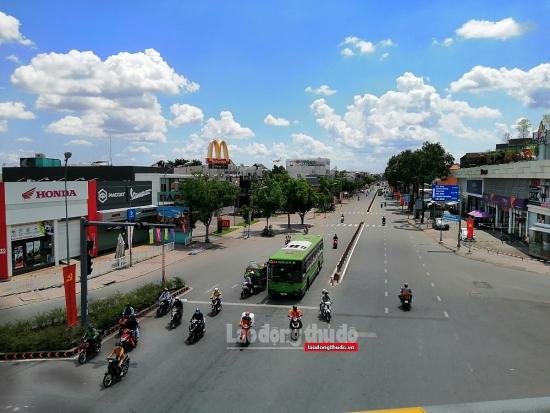 """Ảnh: Thành phố Hồ Chí Minh """"đếm ngày"""" mở cửa trở lại"""