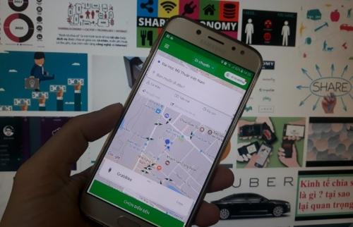 Grab mua lại Uber có dấu hiệu vi phạm?