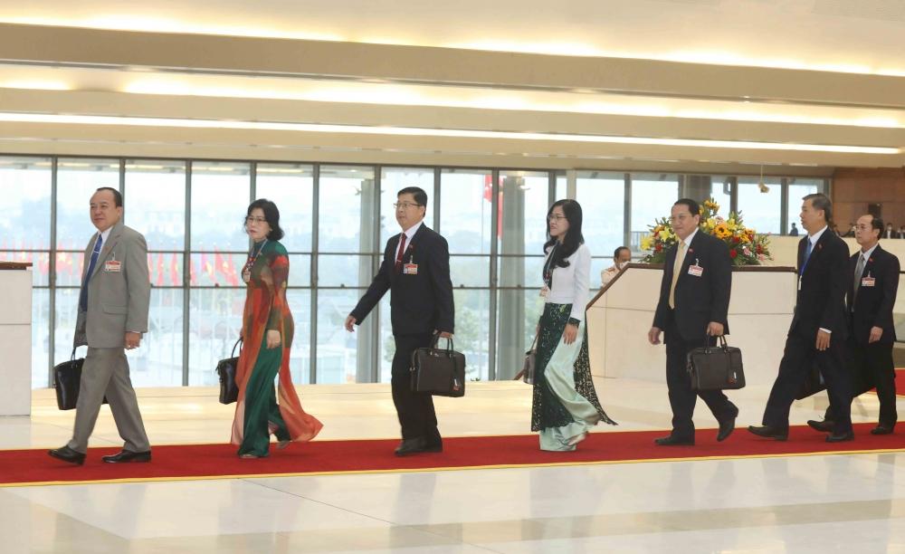 Các đại biểu đến dự phiên họp sáng 30/1.