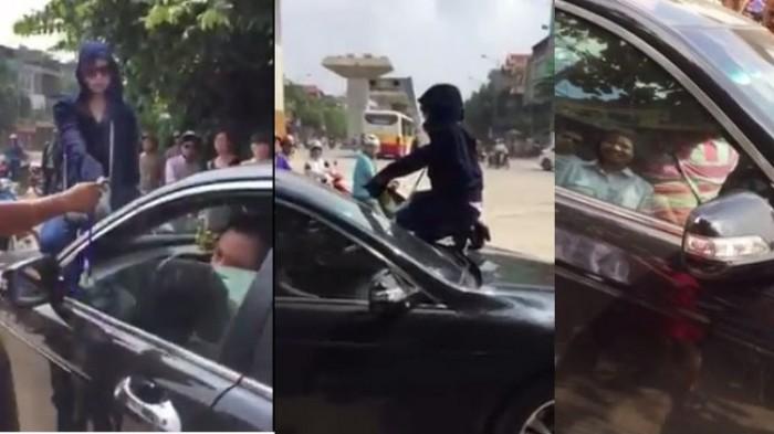 Bị vợ đánh ghen, chồng và nhân tình cố thủ trong xe
