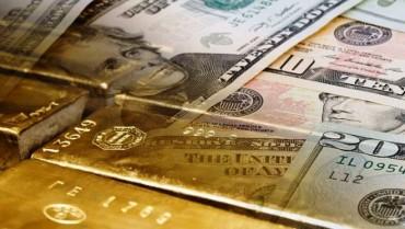 Giá vàng tiếp tục giảm, USD lại tăng mạnh