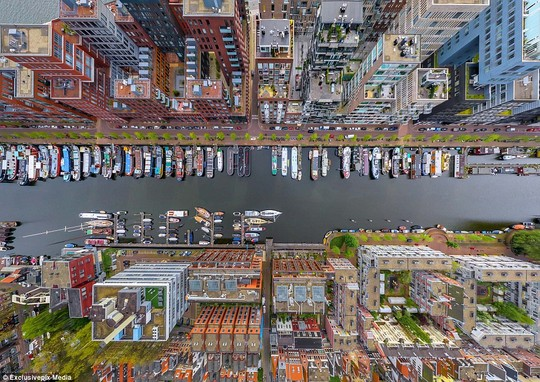 The Westerdok Disctrict in Amsterdam: Boats line the canal in Hollands capital city in this beautiful aeiral photo