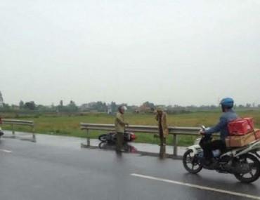 Người phụ nữ bị chém chết khi đang lái xe máy trên đường