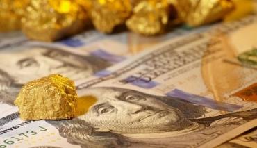 Vàng và USD đồng loạt tăng giá trong sáng nay (5/10)