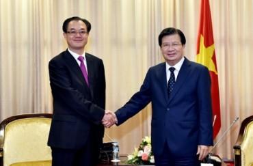 Phó Thủ tướng Trịnh Đình Dũng tiếp Phó Thị trưởng Trùng Khánh (Trung Quốc)